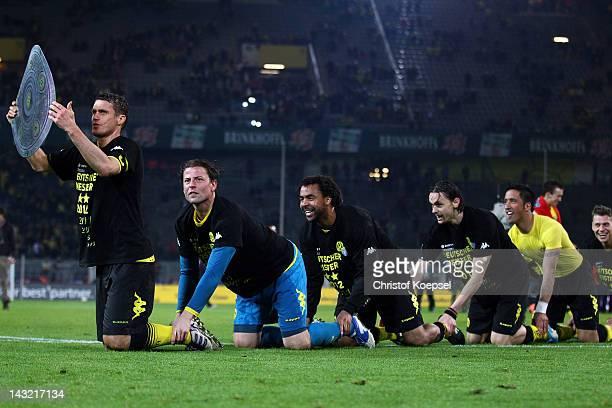 Sebastian Kehl Roman Weidenfeller Patrick Owomoyela Neven Subotic and Lucas Barrios of Dortmund celebrate winning the German Championships after...