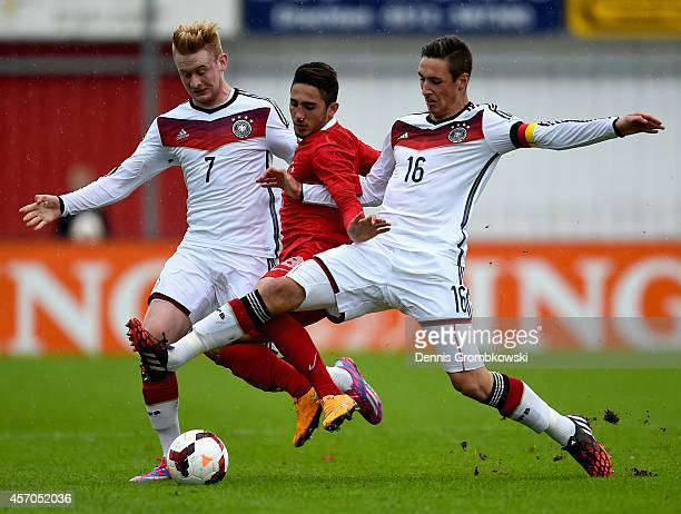 Sebastian Kerk and Dominik Kohr of Germany challenge Vedat Bora of Turkey during the International Under 20 Tournament match between U20 Germany and...