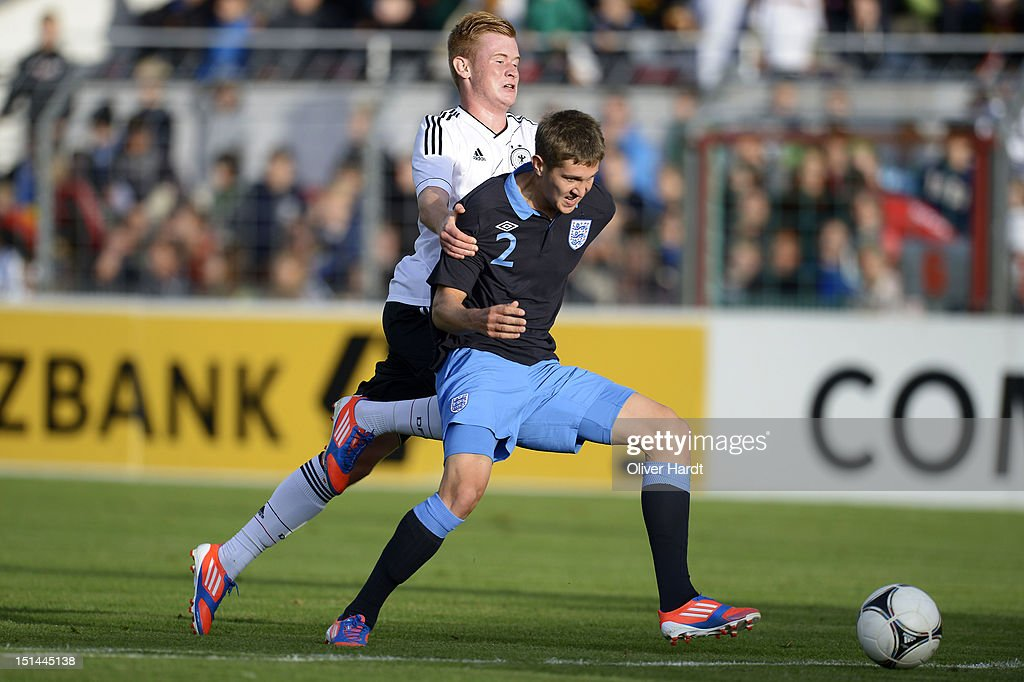 Sebastian Kerk (L) of Germany and John Stones (R) of England battle for the ball during the Under 19 international friendly match between Germany and England at Stadion an der Lohmuehle on September 6, 2012 in Luebeck, Germany.