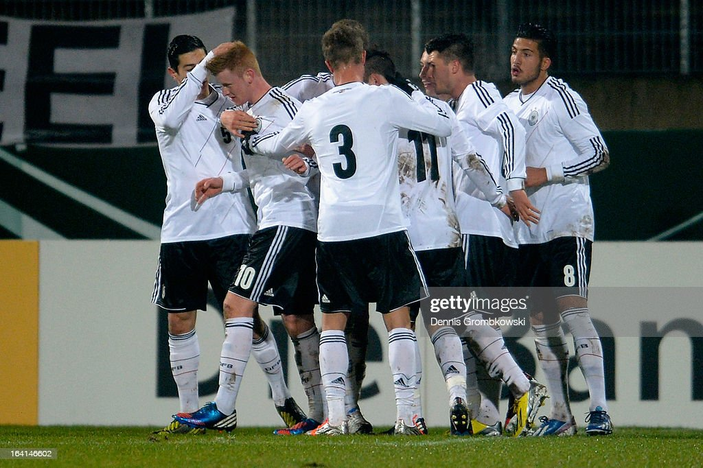 Sebastian Kerk of Germany celebrates with teammates after scoring his team's first goal during the International Friendly match between U19 Germany and U19 Spain on March 20, 2013 in Duesseldorf, Germany.