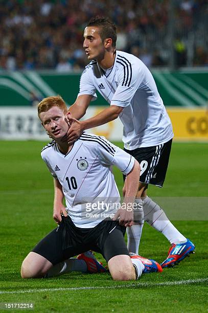 Sebastian Kerk of Germany frustration reacts with Samed Yesil of Germany during the Under 19 international friendly match between Germany and Wales...