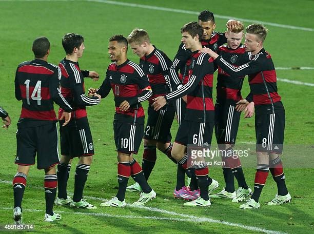 Sebastian Kerk of Germany jubilates with team mates after scoring the second goal after penalty during the U20 international friendly match between...