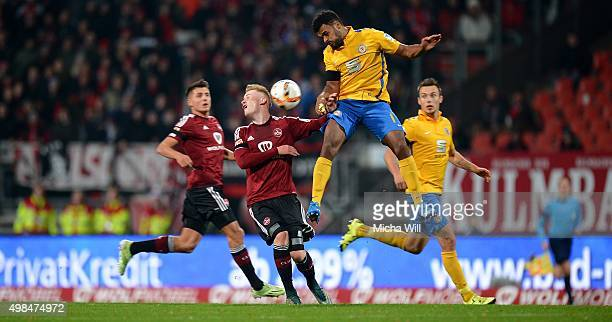 Sebastian Kerk of Nuernberg and Phil OfosuAyeh of Braunschweig compete for the ball during the Second Bundesliga match between 1 FC Nuernberg and...