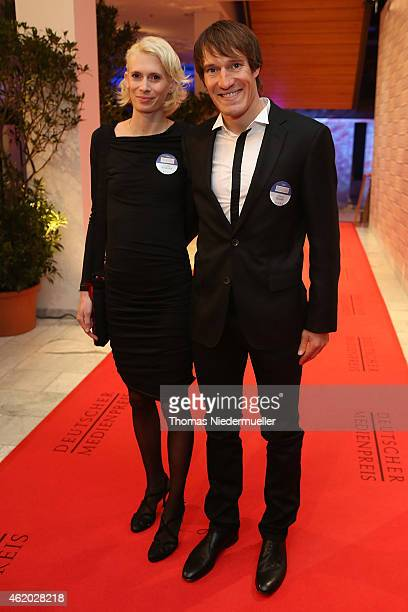 Sebastian Kienle and Christine Schleifer arrive the red carpet during the German Media Award 2014 on January 23 2015 in BadenBaden Germany
