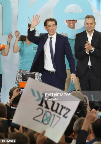 Sebastian Kurz Austrian Foreign Minister and leader of the conservative Austrian People's Party greets supporters after initial results give the...