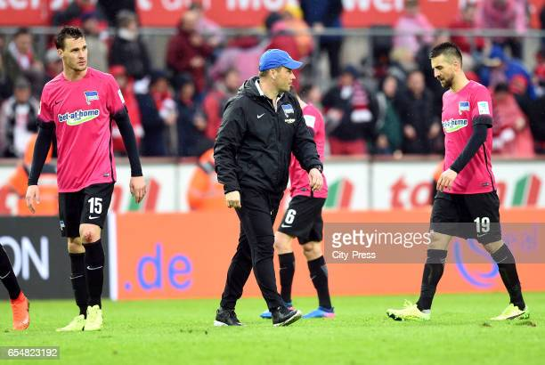 Sebastian Langkamp coach Pal Dardai and Vedad Ibisevic of Hertha BSC after the game between dem 1 FC Koeln and Hertha BSC on march 18 2017 in Koeln...