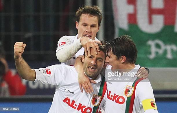 Sebastian Langkamp Edmond Kapllani and Paul Verhaegh of Augsburg celebrate Kapllani's first goal during the Bundesliga match between FC Augsburg and...