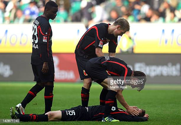 Sebastian Langkamp of Augsburg celebrate with his team mates after the Bundesliga match between VfL Wolfsburg and FC Augsburg at the Volkswagen Arena...
