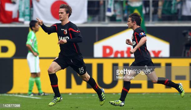 Sebastian Langkamp of Augsburg celebrates after he heads his team's 2nd goal during the Bundesliga match between VfL Wolfsburg and FC Augsburg at the...