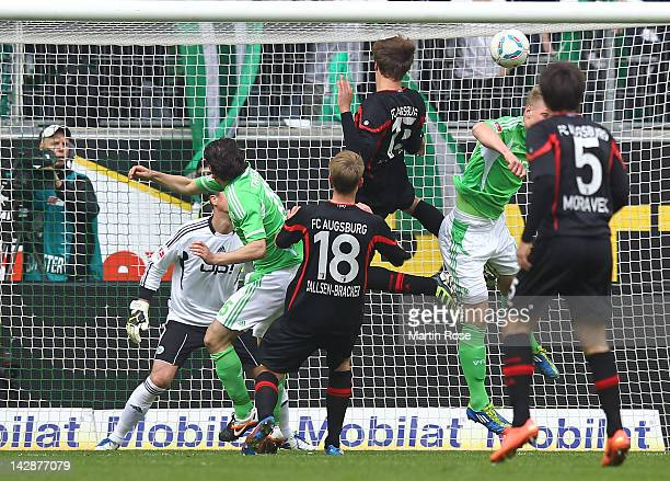 Sebastian Langkamp of Augsburg heads his team's 2nd goal during the Bundesliga match between VfL Wolfsburg and FC Augsburg at the Volkswagen Arena on...