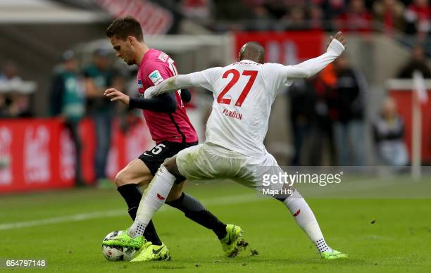 Sebastian Langkamp of Berlin is challenged by Anthony Modeste of Koeln during the Bundesliga match between 1 FC Koeln and Hertha BSC at...