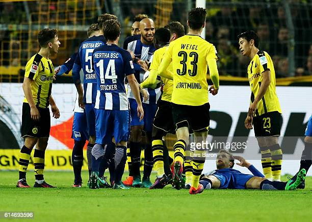 Sebastian Langkamp of Berlin lies on the ground after he was pushed by Emre Mor of Dortmund during the Bundesliga match between Borussia Dortmund and...