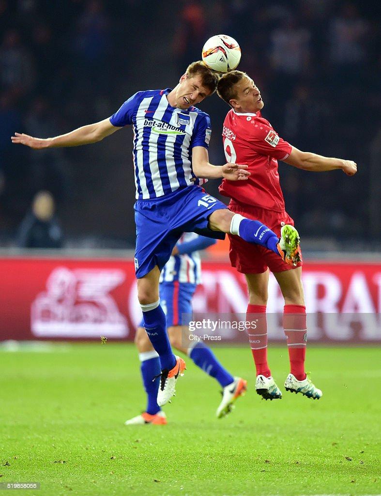 Sebastian Langkamp of Hertha BSC and Artur Sobiech of Hannover 96 during the Bundesliga match between Hertha BSC and Hannover 96 at Olympiastadion on April 8, 2016 in Berlin, Germany.