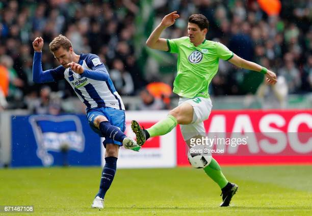 Sebastian Langkamp of Hertha BSC is challenged by Mario Gomez of VfL Wolfsburg during the Bundesliga match between Hertha BSC and VfL Wolfsburg at...