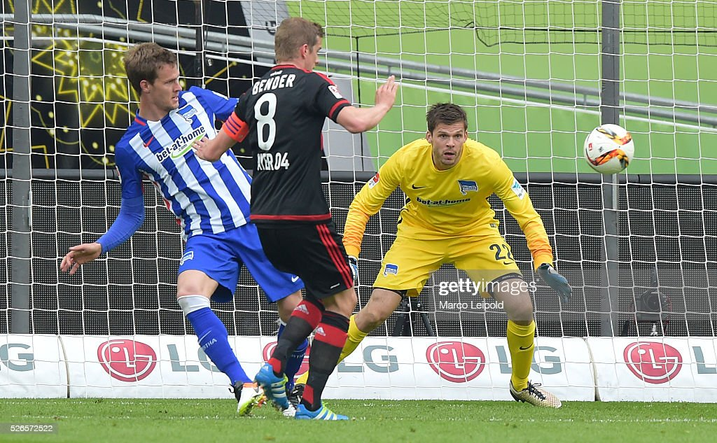 Sebastian Langkamp of Hertha BSC, Lars Bender of Bayer 04 Leverkusen and Rune Almenning Jarstein of Hertha BSC during the game between Bayer 04 Leverkusen and Hertha BSC on april 30, 2016 in Leverkusen, Germany.