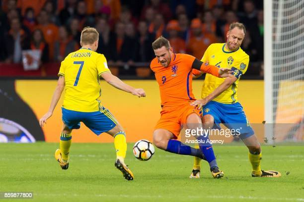 Sebastian Larsson and Andreas Granqvis of Sweden and Vincent Janssen of Netherlands battle for the ball during the FIFA 2018 World Cup Qualifier...