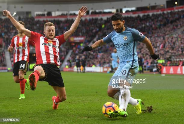 Sebastian Larsson of Sunderland attempts to block Sergio Aguero of Manchester City cross during the Premier League match between Sunderland and...