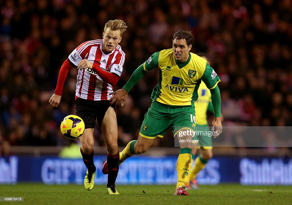 Sebastian Larsson of Sunderland battles with Johan Elmander of Norwich City during the Barclays Premier League match between Sunderland and Norwich City at the Stadium of Light on December 21, 2013 in Sunderland, England.