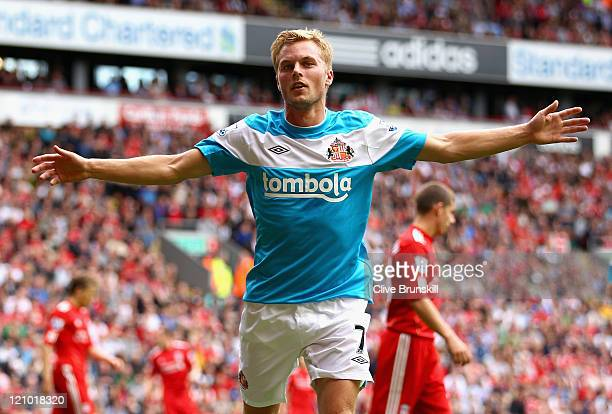 Sebastian Larsson of Sunderland celebrates scoring the equalising goal during the Barclays Premier League match between Liverpool and Sunderland at...