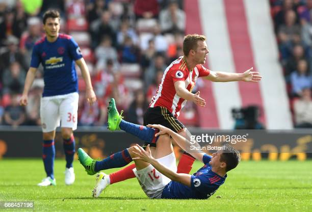 Sebastian Larsson of Sunderland fouls Ander Herrera of Manchester United leading to his sending off during the Premier League match between...