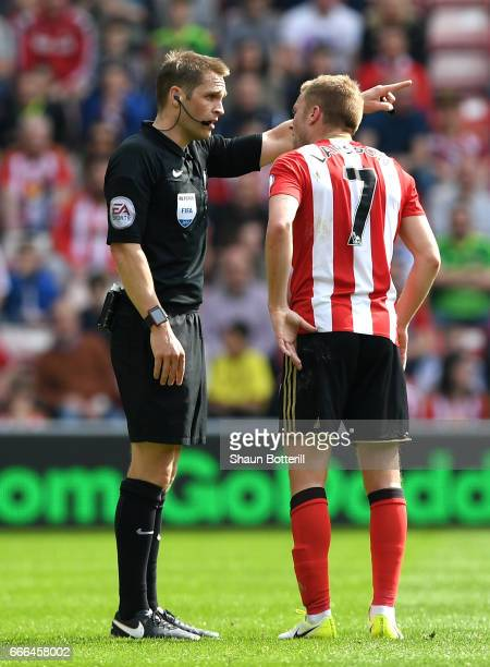 Sebastian Larsson of Sunderland is sent off by referee Craig Pawson for a challenge on Ander Herrera of Manchester United during the Premier League...