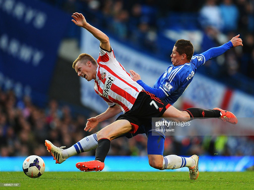 <a gi-track='captionPersonalityLinkClicked' href=/galleries/search?phrase=Sebastian+Larsson&family=editorial&specificpeople=719331 ng-click='$event.stopPropagation()'>Sebastian Larsson</a> of Sunderland is tackled by <a gi-track='captionPersonalityLinkClicked' href=/galleries/search?phrase=Fernando+Torres&family=editorial&specificpeople=194755 ng-click='$event.stopPropagation()'>Fernando Torres</a> of Chelsea during the Barclays Premier League match between Chelsea and Sunderland at Stamford Bridge on April 19, 2014 in London, England.