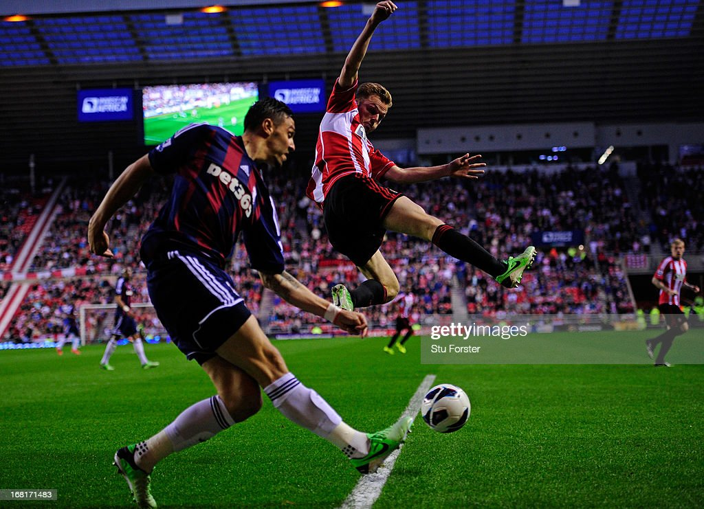<a gi-track='captionPersonalityLinkClicked' href=/galleries/search?phrase=Sebastian+Larsson&family=editorial&specificpeople=719331 ng-click='$event.stopPropagation()'>Sebastian Larsson</a> of Sunderland jumps to block a shot from during the Barclays Premier League match between Sunderland and Stoke City at the Stadium of Light on May 06, 2013 in Sunderland, England.