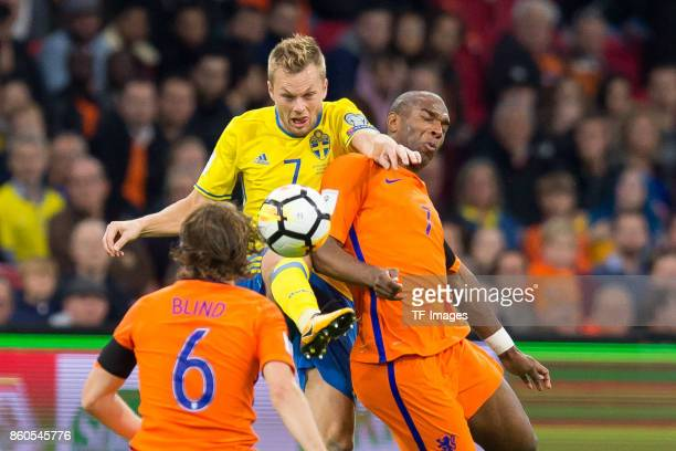 Sebastian Larsson of Sweden and Ryan Babel of Netherlands battle for the ball during the FIFA 2018 World Cup Qualifier between Netherlands and Sweden...