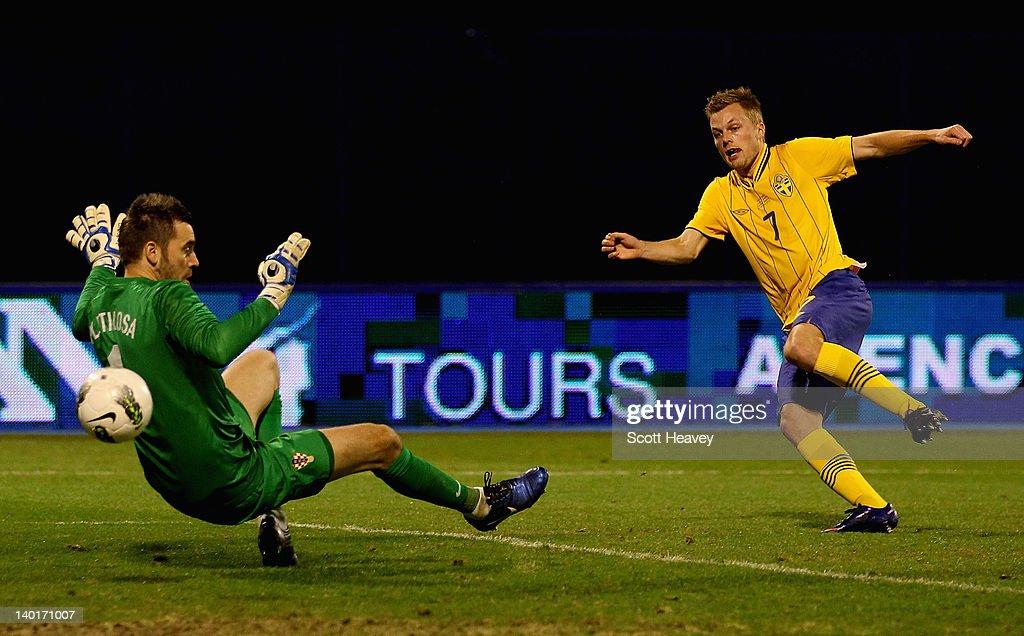Sebastian Larsson of Sweden scores their third goal past Stipe Pletikosa of Croatia during the International Friendly between Croatia and Sweden on...