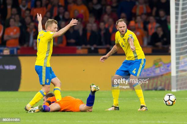 Sebastian Larsson of Sweden Vincent Janssen of Netherlands and Andreas Granqvist of Sweden battle for the ball during the FIFA 2018 World Cup...