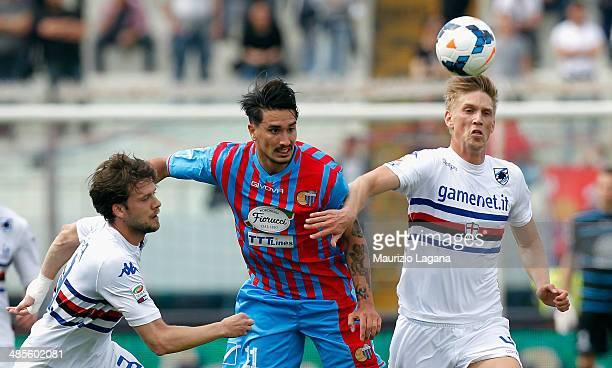 Sebastian Leto of Catania competes for the ball with Andrea Costa and Bartosz Salamon of Sampdoria during the Serie A match between Calcio Catania...