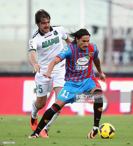 Sebastian Leto of Catania competes for the ball with Francesco Acerbi of Sassuolo during the Serie A match between Calcio Catania and US Sassuolo...