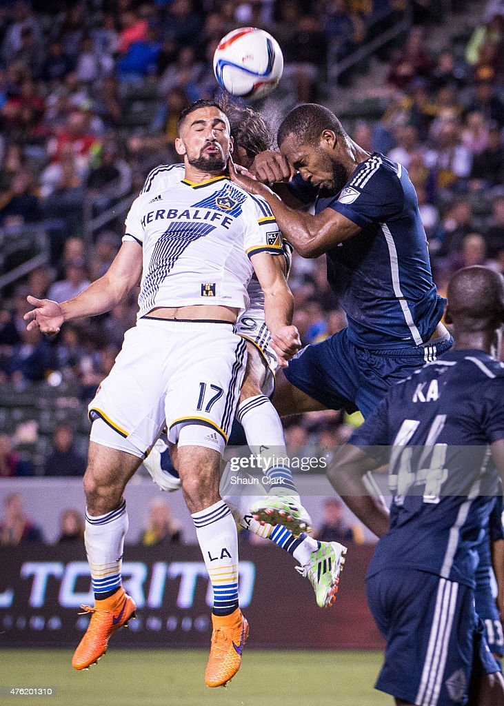 Sebastian Lietget (17) of Los Angeles Galaxy heads the ball in front of <a gi-track='captionPersonalityLinkClicked' href=/galleries/search?phrase=Alan+Gordon+-+Soccer+Player&family=editorial&specificpeople=11667134 ng-click='$event.stopPropagation()'>Alan Gordon</a> (9) of Los Angeles Galaxy and <a gi-track='captionPersonalityLinkClicked' href=/galleries/search?phrase=Kendall+Waston&family=editorial&specificpeople=2488484 ng-click='$event.stopPropagation()'>Kendall Waston</a> (4) of Vancouver FC during the MLS match at the StubHub Center on June 6, 2015 in Carson, California. Vancouver FC won the match 1-0