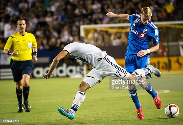 Sebastian Lletget of Los Angeles Galaxy battles Calum Mallace of Montreal Impact during Los Angeles Galaxy's MLS match against Montreal Impact at the...