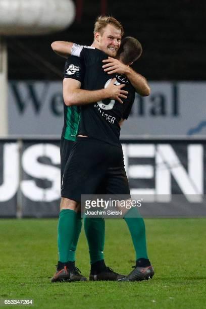 Sebastian Mai and Michele Rizzi of Muenster after the third league match between Preussen Muenster and FSV Frankfurt at Preussenstadion on March 14...