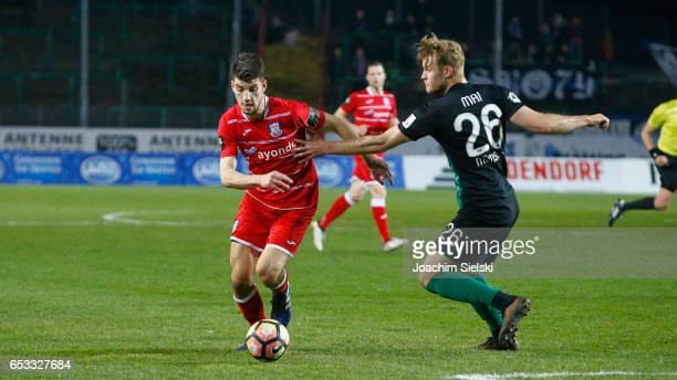 Sebastian Mai of Muenster challenges Cagatay Kader of Frankfurt during the third league match between Preussen Muenster and FSV Frankfurt at...