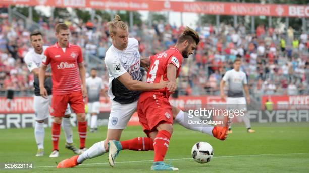 Sebastian Mai of Muenster challenges Dominic Baumann of Wuerzburg during the 3 Liga match between FC Wuerzburger Kickers and SC Preussen Muenster at...