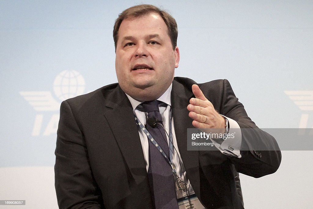 Sebastian Mikosz, chief executive officer of LOT Polish Airlines SA, gestures whilst speaking during the International Air Transport Association's (IATA) annual general meeting in Cape Town, South Africa, on Tuesday, June 4, 2013. Airline earnings will be 20 percent higher this year than forecast just three months ago as capacity cuts help pack planes to record levels, the International Air Transport Association said today. Photographer: Nadine Hutton/Bloomberg via Getty Images