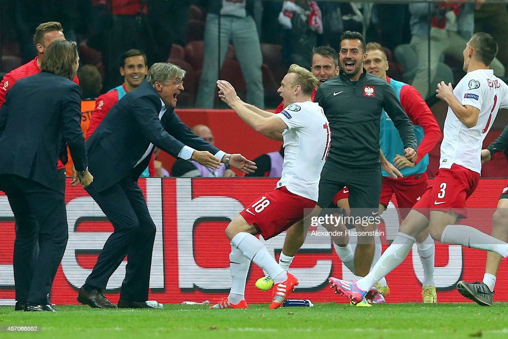 Sebastian Mila of Poland celebrates scoring the 2nd team goal with his head coach Adam Nawalka during of the EURO 2016 Group D qualifying match...