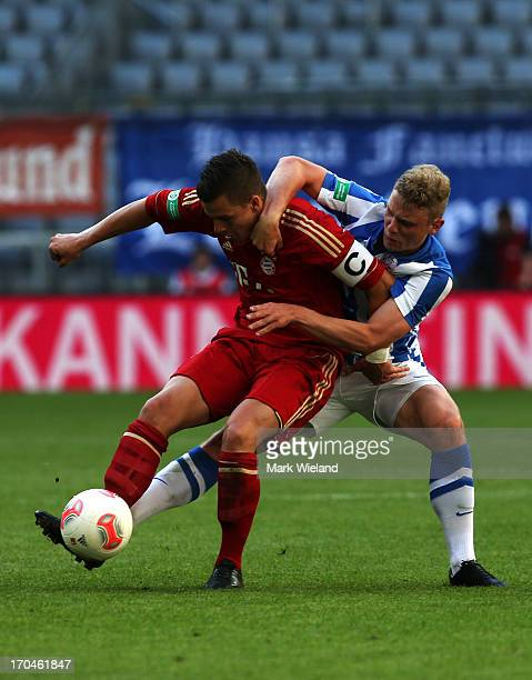 Sebastian Mrowca of FC Bayern Muenchen U19 fights for the ball with Christian Flath of Hansa Rostock U19 during the A Juniors championship first leg...