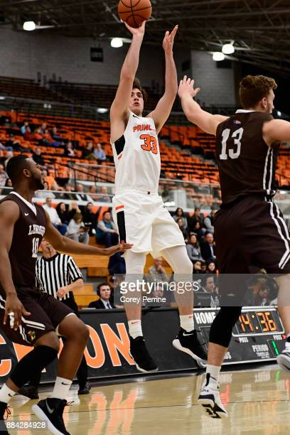Sebastian Much of the Princeton Tigers shoots the ball between Ed Porter and James Karnik of the Lehigh Mountain Hawks during the first half at L...