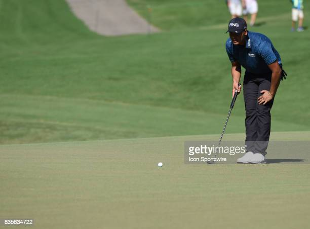 Sebastian Munoz looks over his putt on the 5th hole during the first round of the Wyndham Championship on August 18 2017 at Sedgefield Country Club...