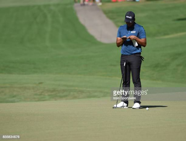 Sebastian Munoz looks over the card during the first round of the Wyndham Championship on August 18 2017 at Sedgefield Country Club in Greensboro NC