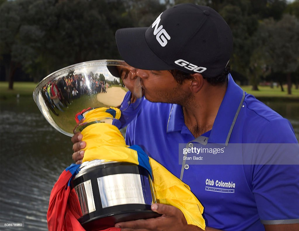 Sebastian Munoz of Colombia kisses the winner's trophy after the final round of the Web.com Tour Club Colombia Championship Presented by Claro at Bogotá Country Club on February 7, 2016 in Bogotá, Colombia.