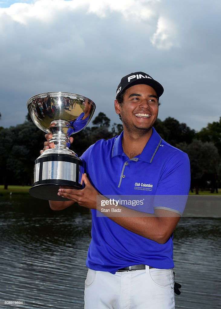 Sebastian Munoz of Colombia poses with the winner's trophy after the final round of the Web.com Tour Club Colombia Championship Presented by Claro at Bogotá Country Club on February 7, 2016 in Bogotá, Colombia.