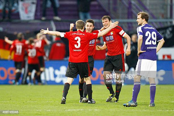 Sebastian Neumann of Osnabrueck looks dejected next to Silvio Bankert Kevin Conrad and Marc Hensel of Chemnitz during the Third league match between...