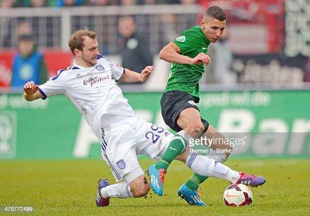 Sebastian Neumann of Osnabrueck tackles Soufian Benyamina of Muenster during the Third League match between Preussen Muenster and VfL Osnabrueck at...