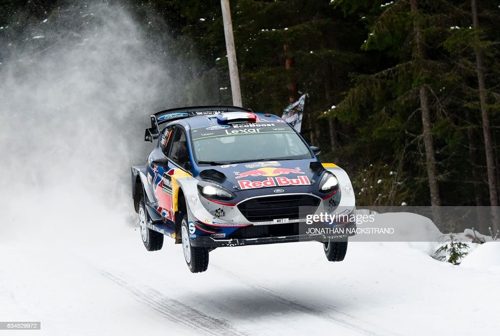 TOPSHOT - Sebastian Ogier of France and his co-driver Julien Ingrassia compete in their Ford Fiesta WRC during the 5th stage of the Rally Sweden, second round of the FIA World Rally Championship on February 10, 2017 in Rojden, Norway. / AFP PHOTO / Jonathan NACKSTRAND