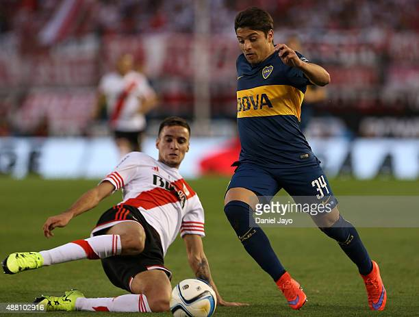 Sebastian Palacios of Boca Juniors dribbles past Emanuel Mammana of River Plate during a match between River Plate and Boca Juniors as part of 24th...