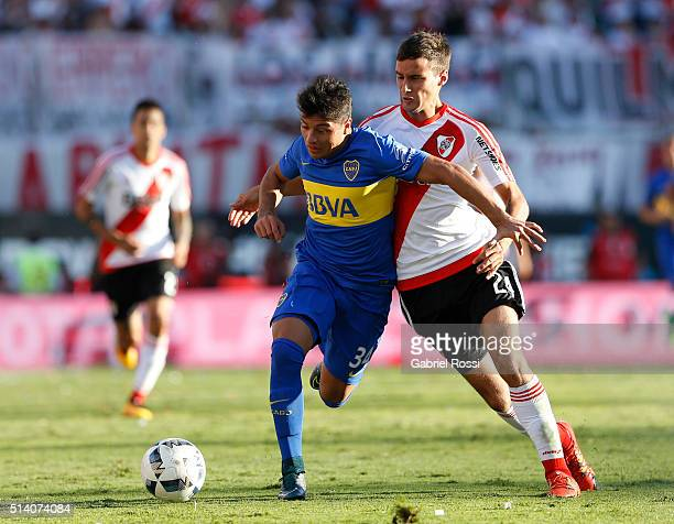 Sebastian Palacios of Boca Juniors fights for the ball with Emanuel Mammana of River Plate during a match between River Plate and Boca Juniors as...
